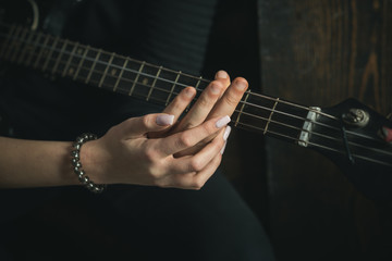 Music is their passion. Couple of guitar players. Couple in love play duets. Male and female hands play the electric guitar. Couple of musicians enjoy playing music. Instrumental music live