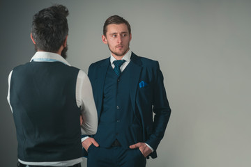 The details make the suit. Men wear fashion business formal style. Friends in friendship relations. Fashion models in business relations. Bonds of friendship and cooperation among businessmen