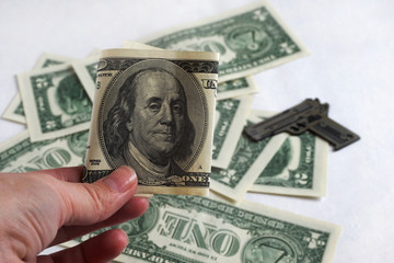 franklin in hand amid money and weapons