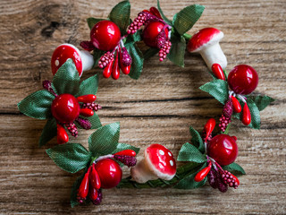 Christmas wreath on wood background