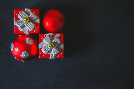 gift red box decoration with ribbon on the black background