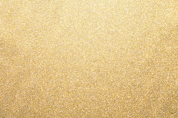 Gold glitter background, shiny paper defocused