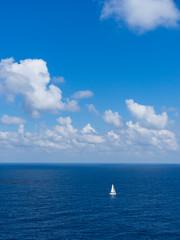 the white sailing boat on blue sea