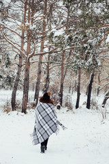 girl in winter in a plaid plaid