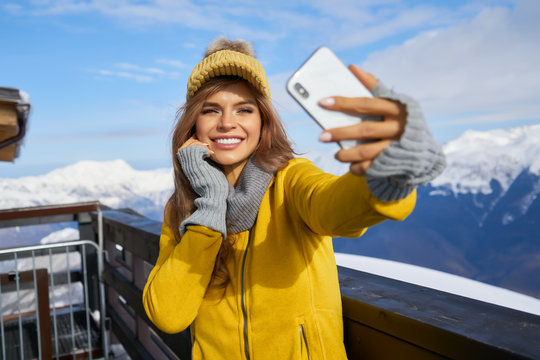 Young woman taking a selfie in winter holiday in mountain.