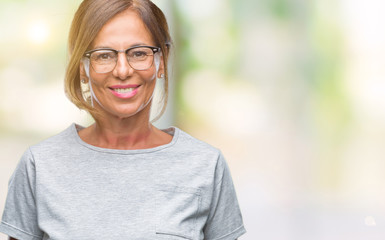 Middle age senior hispanic woman wearing glasses over isolated background with a happy and cool smile on face. Lucky person.