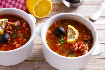 Russian dish  solyanka - thick, spicy and sour saltwort soup. horizontal
