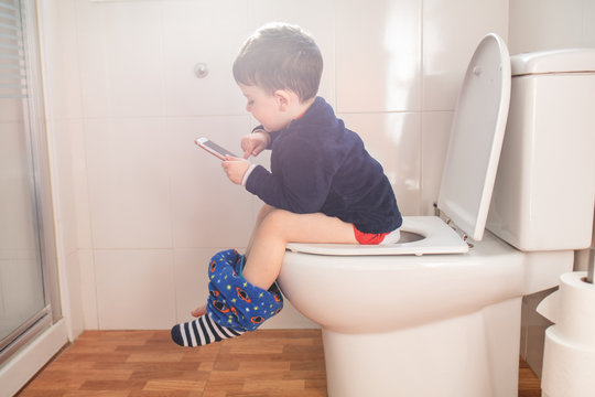 boy with phone in bathroom