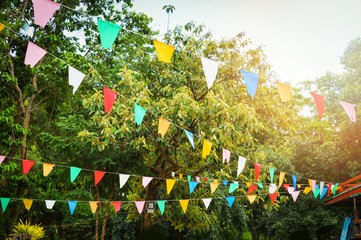 Colorful party flags made of paper / Triangle paper flag hang in the garden decorate in event
