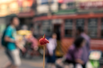 Strawberry on stick on the street of Bangkok, Thailand.