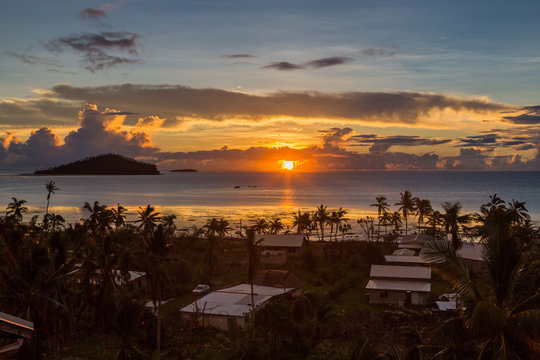 Early morning and sunrise over Pacific Ocean in Mata-Utu village, the capital of Wallis and Futuna territory (Wallis-et-Futuna), French overseas island collectivity. Downtown is overgrown with palms