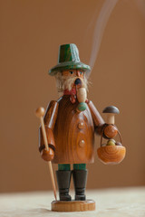 A hand-made Smoker Figurine, traditional German Christmas Decoration from the Erzgebirge Region in Eastern Germany