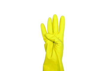 Signs made of yellow protective gloves. Fingers symbol four. Isolated on white. The concept of cleanliness and order.