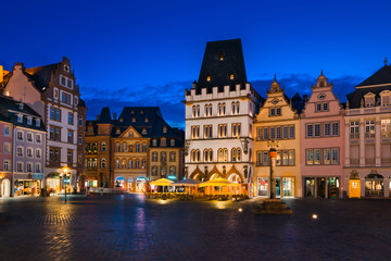 The Main Market of Trier, Germany at night. It is the center of the medieval Trier surrounded by numerous historic buildings.