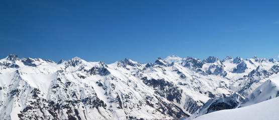 Fototapete - Panorama of snow covered mountains in winter