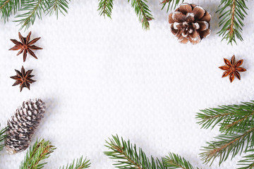 Christmas composition on white knitted background.