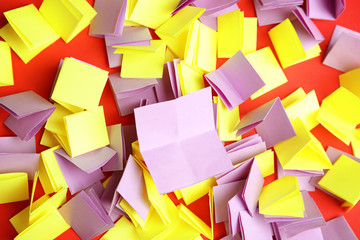 Pile of paper pieces for lottery on color background