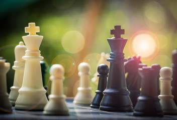 Black and White King and Knight of chess battle on board . Black king are leader to fight with teamwork to victory. Leader and teamwork concept for success. Competition and defeating concept