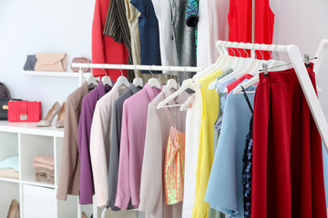 Racks with different stylish clothes in boutique