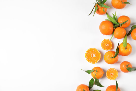 Flat lay composition with ripe tangerines on white background. Space for text