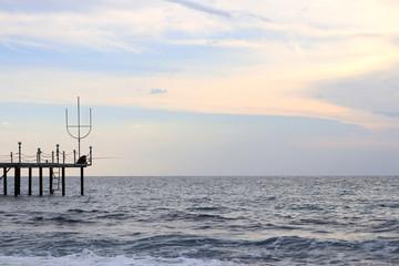 Fisherman on the pier. Black Sea landscape. Alanya. Turkey.