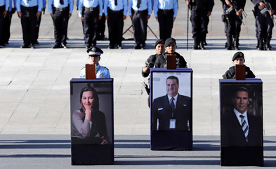 Urns with ashes of Martha Erika Alonso, a senior opposition figure and governor of the state of Puebla, her husband Senator Rafael Moreno and a crew member are displayed over their photographs during a homage in Puebla