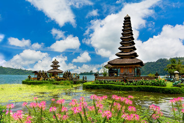 Pura Ulun Danu temple with pink flowers on a lake Bratan, Bali, Indonesia