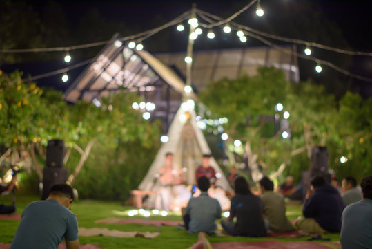 Blurry shots are held in the garden at night, adorned with beautiful lighting.