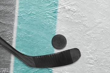 Hockey stick, puck and ice arena fragment with black and blue-green lines
