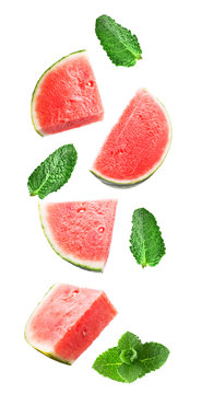 Flying sweet watermelon and mint isolated on white