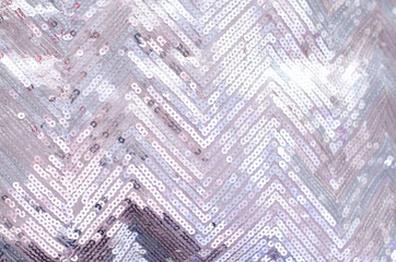 Fabric texture with shimmering silver sequins.