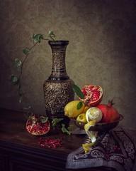 Still life with pomegranates and lemons