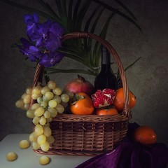 Still life with orchid flower and fruits