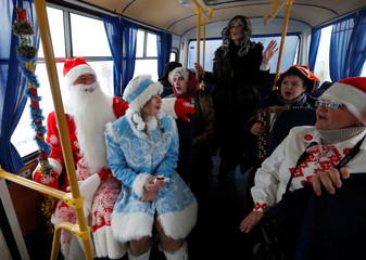 People dressed as Father Frost, Snow Maiden and other characters take part in the congratulations of state farm workers in the village of Krutilavichy