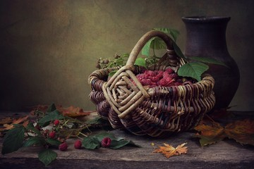 Still life with raspberry basket