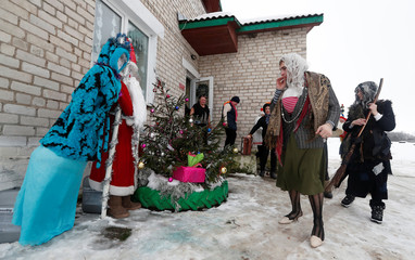 People dressed as Father Frost, Snow Maiden and other characters take part in the congratulations of state farm workers in the village of Tarkachy