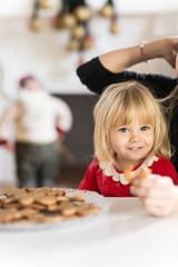 Single mom enjoying with baby daughter in Christmas cake