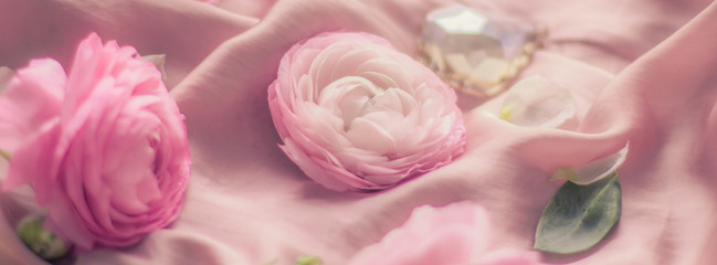 pink rose flowers on soft silk - wedding, holiday and floral background styled concept