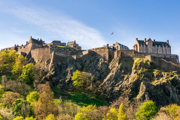 Edinburgh Castle, historic fortress built on the top of a volcanic rock, on a beautiful blue sky Spring day, famous tourist attraction in Scotland, UK.
