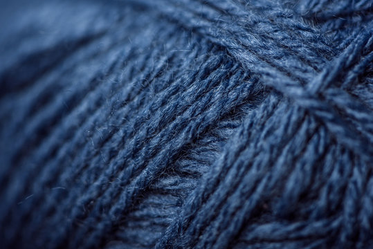 full frame of blue yarn texture as background