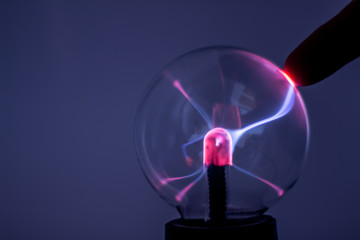 A plasma lamp with pink electricity rays.