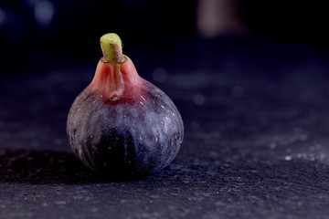 Fresh figs on black background