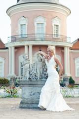 Bride blonde in a luxurious wedding dress