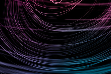 Abstract background of long explosure tale purple and blue light