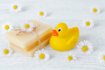 handmade natural soap with chamomile flowers and a duck toy