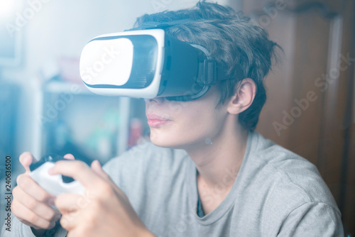 a2bb59a99c8 young emotional boy using virtual reality vr headset at home and play games  f
