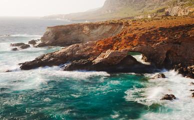 Ghar Hanex. Rocky coastline of Malta