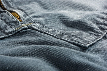 clothing items washed cotton fabric texture with seams, clasps, buttons and rivets