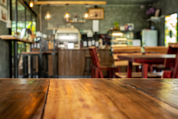 Background image Wood table top on blur coffee shop background