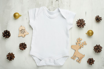 Layout Flat Lay a white baby bodysuit on a white background, with children's wooden toys. Choose design and placement of logos, advertising